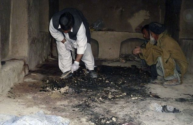 Appears to be a March 11, 2012 photograph of the interior of the Mohammad Wazir home in Balandi/Najiban, Panjwai district, Afghanistan where 10 of 11 murdered family members were burned