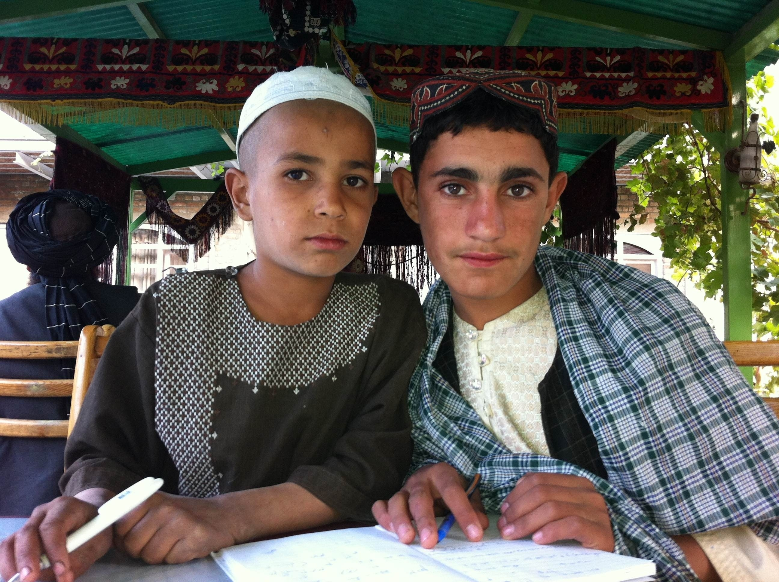 Fall, 2012 Mamoon Durrani photograph of two boys (Hekmatullah, 10, and Rafiullah, 15) who witnessed the Sunday, March 11, 2012 massacre in separate villages in Panjwai district, Kandahar province, Afghanistan