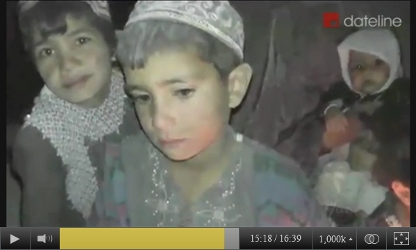 A screen-captured image of 3 of the children around the widow of Mohammad Dawood of Balandi/Najiban, who was killed on March 11, 2012. Recorded by SBS-TV in late March, 2012