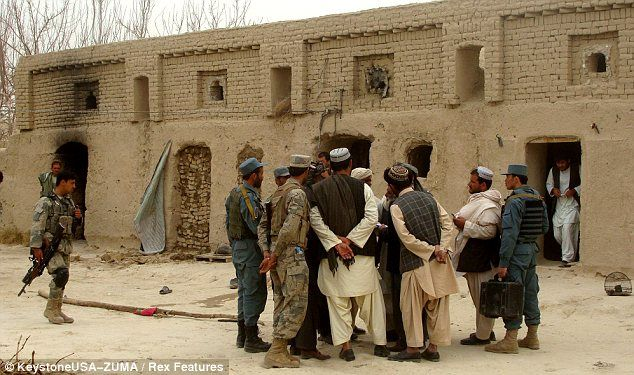 A March 11, 2012 photograph of the Mohammad Wazir home's exterior, showing smoke damage, in Balandi/Najiban village, Panjwai district, Afghanistan
