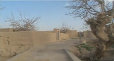 Screen-captured image of Alkozai village lane in Panjwai district, Kandahar province, Afghanistan, from March 23, 2012 footage by DatelineSBS of Australia