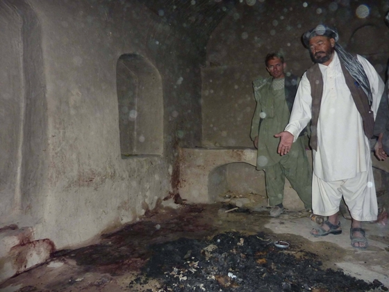 A photograph of Agha Lala in the room in the Mohammad Wazir home where 10 bodies were found on 3/11/2012